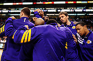 Feb. 19, 2012; Phoenix, AZ, USA;  Los Angeles Lakers forward Pau Gasol (left) and guard Andrew Goudelock reacts with teammates in a huddle while playing Phoenix Suns at the US Airways Center.  The Suns defeated the Lakers 102-90. Mandatory Credit: Jennifer Stewart-US PRESSWIRE.