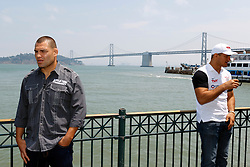 SAN FRANCISCO, CA - JULY 29: Cain Velasquez (L) and Junior dos Santos (R) stand in front of the Bay Bridge during a UFC press tour event on July 29, 2013 in San Francisco, California.  (Photo by Jason O. Watson/Zuffa LLC/Zuffa LLC via Getty Images) *** Local Caption *** Cain Velasquez; Junior dos Santos