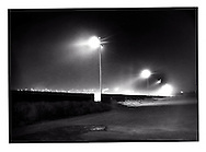 Massive flood lights illuminate the Tijuana River from the US side of the border to eliminate the cover of darkness from Mexicans attempting to cross into the United States, San Ysidro, California, USA..