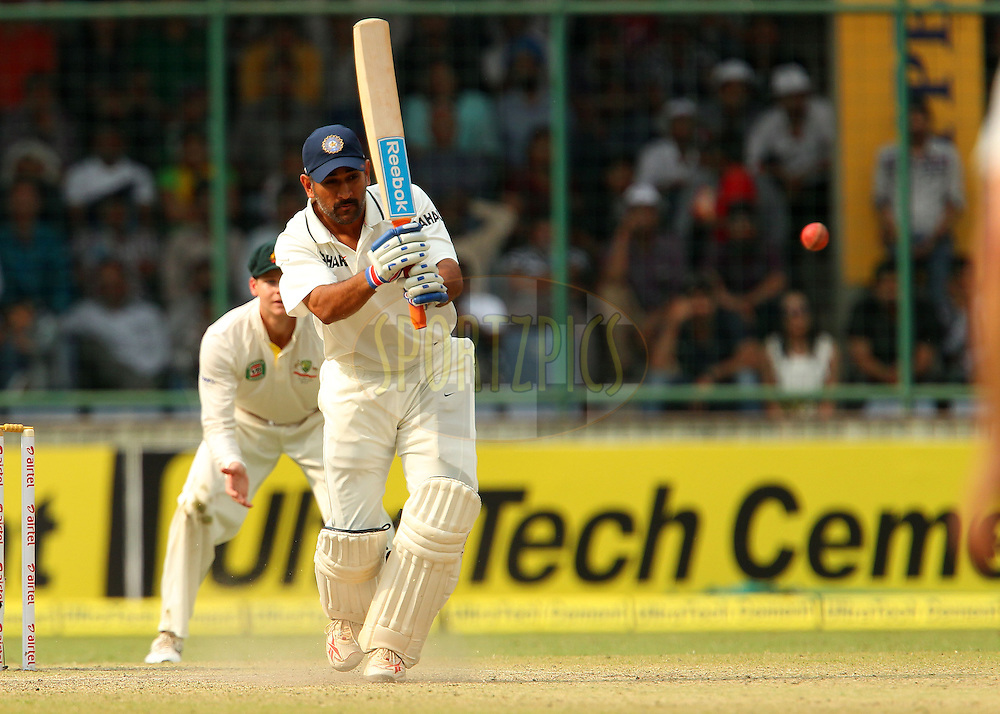 MS Dhoni of India during day 3 of the 4th Test Match between India and Australia held at the Feroz Shah Kotla stadium in Delhi on the 24th March 2013..Photo by Ron Gaunt/BCCI/SPORTZPICS ..Use of this image is subject to the terms and conditions as outlined by the BCCI. These terms can be found by following this link:..http://www.sportzpics.co.za/image/I0000SoRagM2cIEc