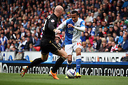 Blackburn Rovers&rsquo;  Markus Olsson looks to go past Wigan Athletic&rsquo;s Stephen Crainey. Skybet football league championship match, Blackburn Rovers v Wigan Athletic at Ewood Park in Blackburn, England on Saturday 3rd May 2014.<br /> pic by Chris Stading, Andrew Orchard sports photography.