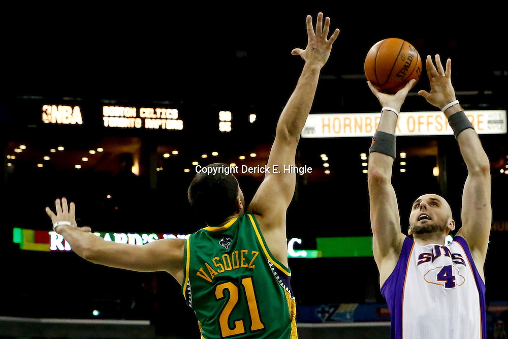Feb 6, 2013; New Orleans, LA, USA; Phoenix Suns center Marcin Gortat (4) shoots over New Orleans Hornets point guard Greivis Vasquez (21) during the second half of a game at the New Orleans Arena. The Hornets defeated the Suns 93-84. Mandatory Credit: Derick E. Hingle-USA TODAY Sports