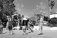 Children playing with bubbles Balboa Park.