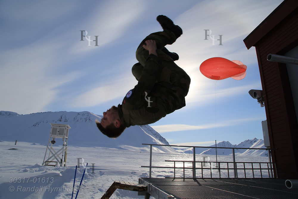 Norwegian soldier flips off near tethered weather blimp porch at the French-German AWIPEV research station in the international science village of Ny-Alesund on Spitsbergen island in Kongsfjorden; Svalbard, Norway.