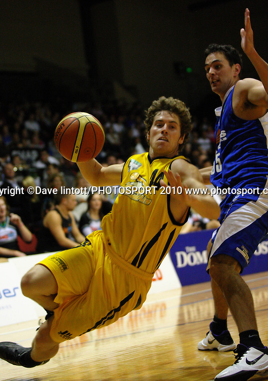 Taranaki guard Jack Leasure slips under pressure from Troy McLean.<br /> NBL - Wellington Saints vTaranaki Mountainairs TSB Bank Arena, Wellington.Friday, 9 April 2010. Photo: Dave Lintott/PHOTOSPORT