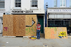 © Licensed to London News Pictures. 24/08/2012. London, UK Shops and premises are boarded up today 24th August 2012 ahead of the Notting Hill Carnival which takes place this weekend.  Photo credit : Stephen Simpson/LNP