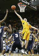 24 JANUARY 2007: Iowa guard/forward J.R. Angle (4) tries to grab a rebound over Penn State guard/forward Geary Claxton (5), guard Ben Luber (3), and forward Milos Bogetic (41) in Iowa's 79-63 win over Penn State at Carver-Hawkeye Arena in Iowa City, Iowa on January 24, 2007.