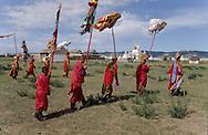 Mongolia. building a yurt Col De Solunghot, (center )  Assemblage du toit de la yourte (ger).  (Col de Solonghot dans l'aymag de Arqangay, Mongolie Après avoir monté la structure en bois de la yourte, on la recouvre avec des pans de feutre qui sont préalablement assemblés par un point de couture. Ce travail est réalisé par les femmes, tandis que les hommes sont affectés au montage. Le feutre sera ensuite recouvert entièrement par un tissu blanc. (Col de SOLONGOT dans l'aymag de ARQANGAI,    14