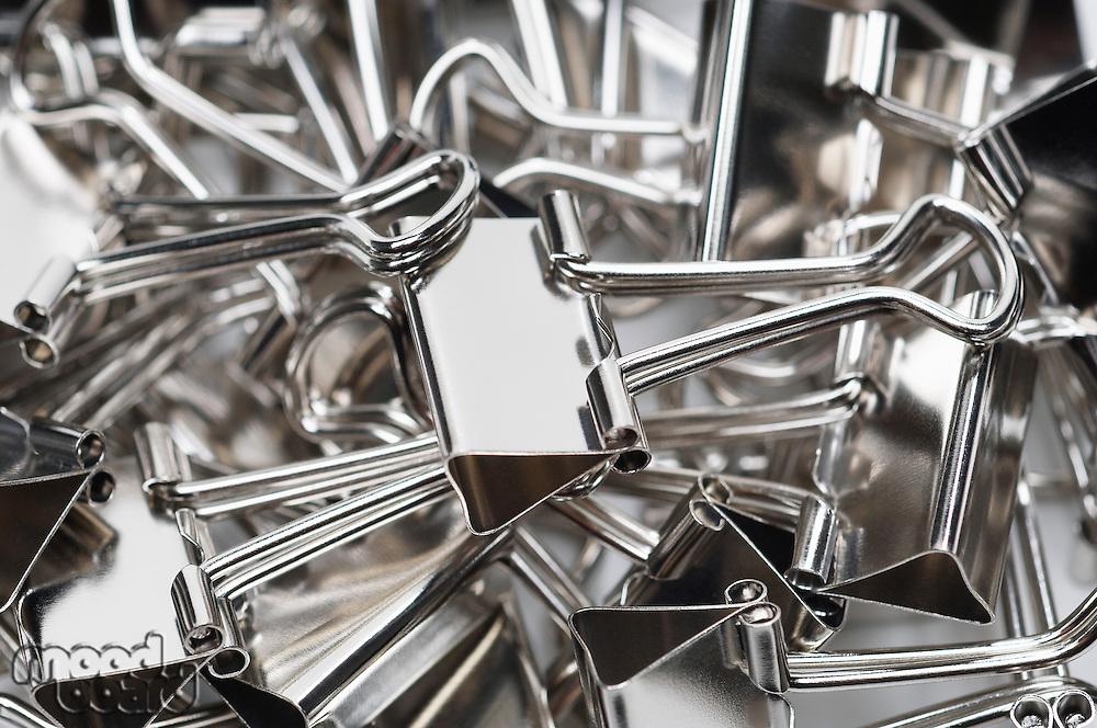 Heap of binder clips, close-up