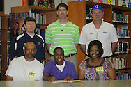 Oxford High basketball player Brittani Smith signs to play softball for Northwest Community College in Oxford, Miss. on Wednesday, April 13, 2010.