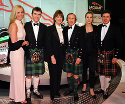 Left to right, MR & MRS PAUL STEWART, MR & MRS JACKIE STEWART he is the former world champion racing driver and MR & MRS MARK STEWART, at a dinner in London on 25th January 2000.OAI 136