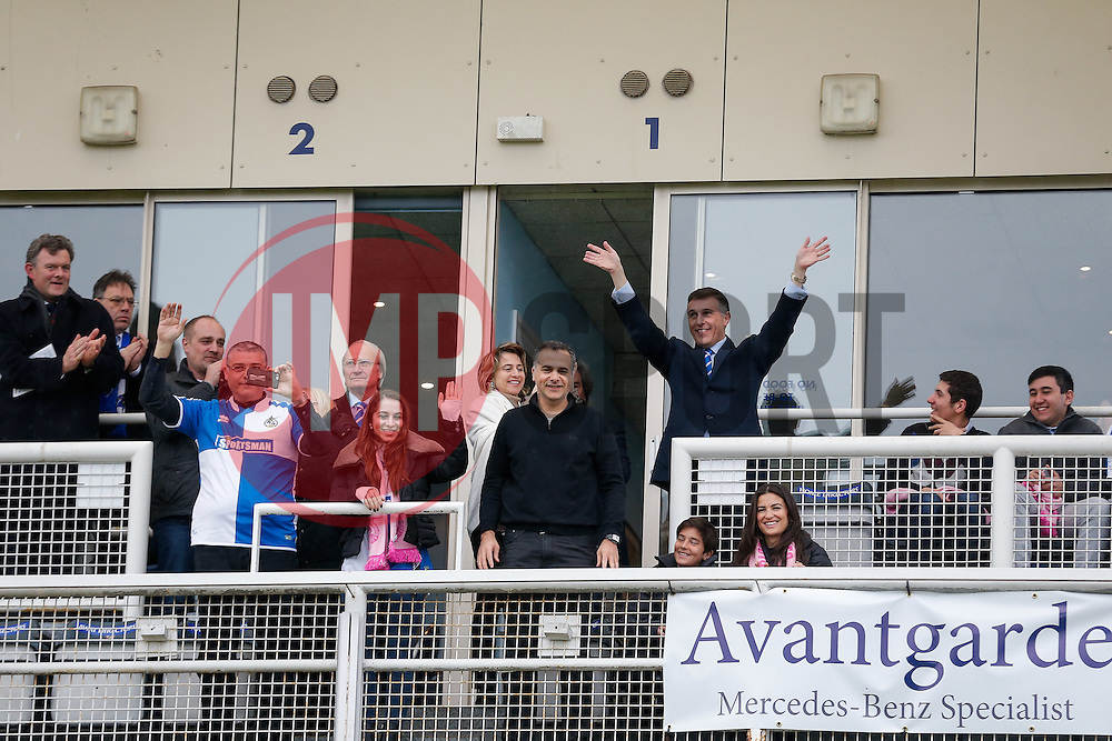 New Bristol Rovers President Wael Al-Qadi (centre) and members of his family including brothers Samer Al-Qadi (left in Rovers shirt) and Hani Al-Qadi (top right) wave to the fans from the Directors box before the match - Mandatory byline: Rogan Thomson/JMP - 07966 386802 - 20/02/2016 - FOOTBALL - Memorial Stadium - Bristol, England - Bristol Rovers v Morecambe - Sky Bet League 2.