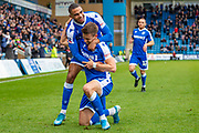 Gillingham FC midfielder Olly Lee  (22) (kneeling) scores a goal (2-0) and celebrates with team mate Gillingham FC forward Mikael Mandron (9) during the The FA Cup match between Gillingham and Doncaster Rovers at the MEMS Priestfield Stadium, Gillingham, England on 1 December 2019.