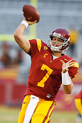 September 11, 2010; Los Angeles, CA, USA;  Southern California Trojans quarterback Matt Barkley (7) throws the ball before the game against the Virginia Cavaliers at the Los Angeles Memorial Coliseum.