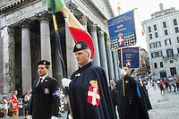 ROME, ITALY - 29 JULY 2014: Honor Guards to the royal tombs of the Pantheon step out of the Pantheon after attending a mass that commemorated the anniversary of the assassination of King Umberto I (King of Italy between 1878 and 1900), in Rome, Italy, on July 29th 2014.<br /> <br /> The National Institute for the Honor Guards to the royal tombs of the Pantheon is a monarchic-oriented whose goal is to watch over the royal tombs at the Pantheon. Italy's first king, Vittorio Emanuele II and his son Umberto I, as well as Umberto's wife Queen Margherita are entombed in the Pantheon.