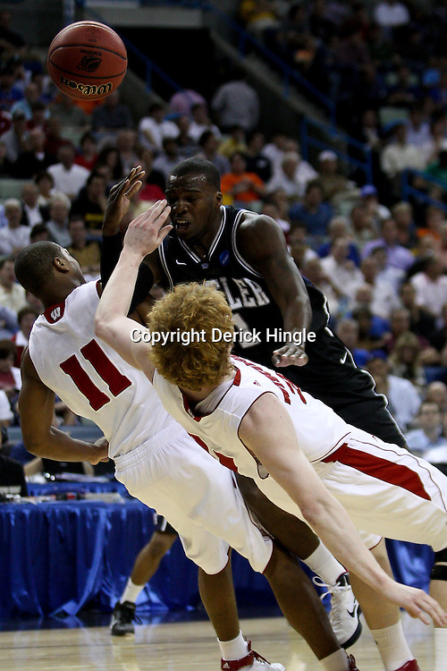 Mar 24, 2011; New Orleans, LA; Butler Bulldogs guard Shelvin Mack (1) collides with Wisconsin Badgers forward Mike Bruesewitz (31) and guard Jordan Taylor (11) during the first half of the semifinals of the southeast regional of the 2011 NCAA men's basketball tournament at New Orleans Arena.  Mandatory Credit: Derick E. Hingle