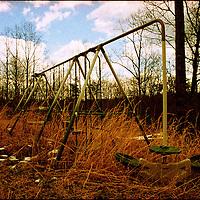 Disused swings in long grass