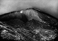 Pacaya Volcano erupts just after sunset as trekkers scurry for cover.  Near Guatemala City, Guatemala.