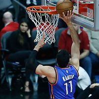 16 January 2017: Oklahoma City Thunder center Enes Kanter (11) goes for the layup past LA Clippers center Marreese Speights (5) during the LA Clippers 120-98 victory over the Orlando Magic, at the Staples Center, Los Angeles, California, USA.