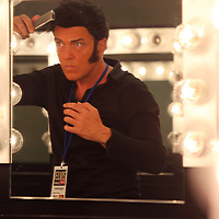Elvis Tribute Artist Matt King, from London England, fixes his hair as he gets ready for his round one performance in the Ultmate Elvis Tribute Artist Competition at the BancorpSouth Arena on Friday morning.