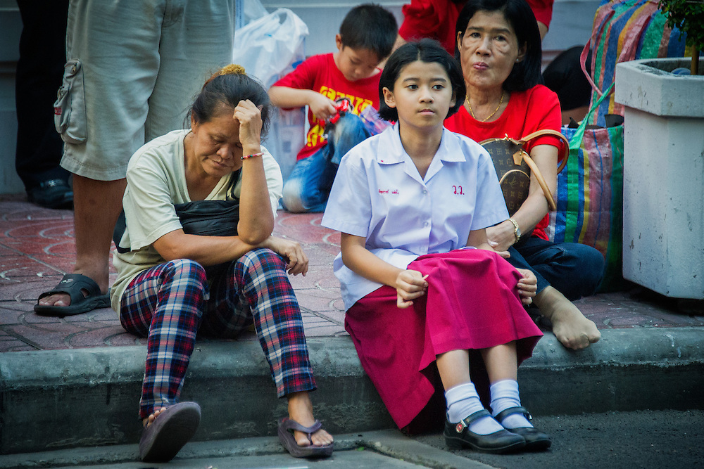 Spectators wait for nearly three hours for Princess Sirindhorn's motorcade, which passed this location in cars fitted with tinted windows, disappointing the throngs of admirers who had hoped to catch a glimpse of Thai royalty.