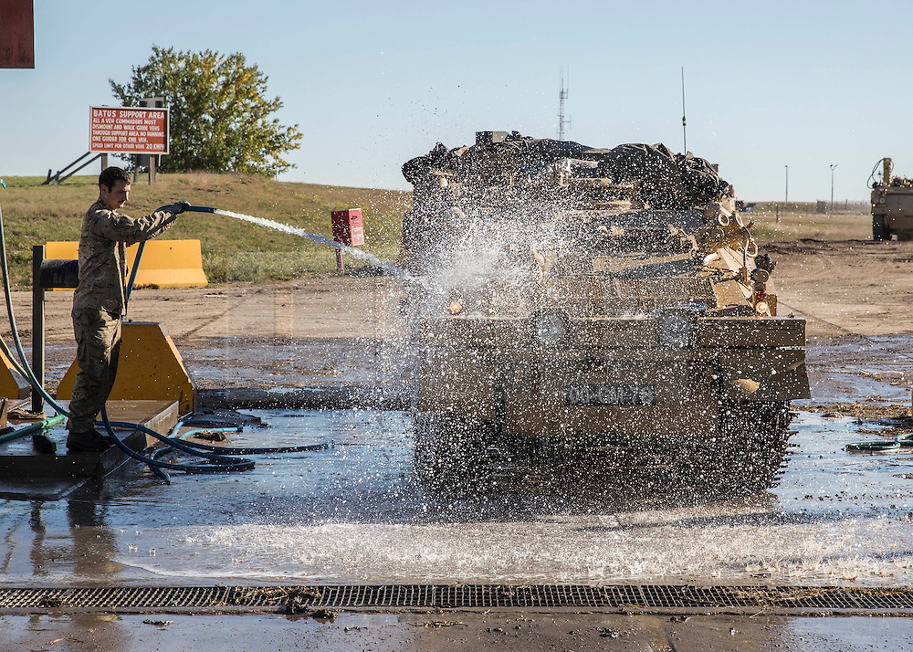 © Licensed to London News Pictures. 08/10/2014.  British Army Training Unit Suffield (BATUS), Canada. As exercise Prairie Storm 3 comes to an end the vehicles are washed down ready for the next exercise.  <br /> <br /> BATUS has been home to the Army for the past 42 years .  It is the only place where all elements of the British Army train together for war.  The soldiers are put to test on everything from armoured vehicles to infantry tactics.        Photo credit : Alison Baskerville/LNP