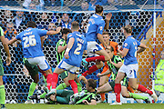 Where's the ball? nothing comes from this glamour scramble during the Sky Bet League 2 match between Portsmouth and AFC Wimbledon at Fratton Park, Portsmouth, England on 15 November 2015. Photo by Stuart Butcher.