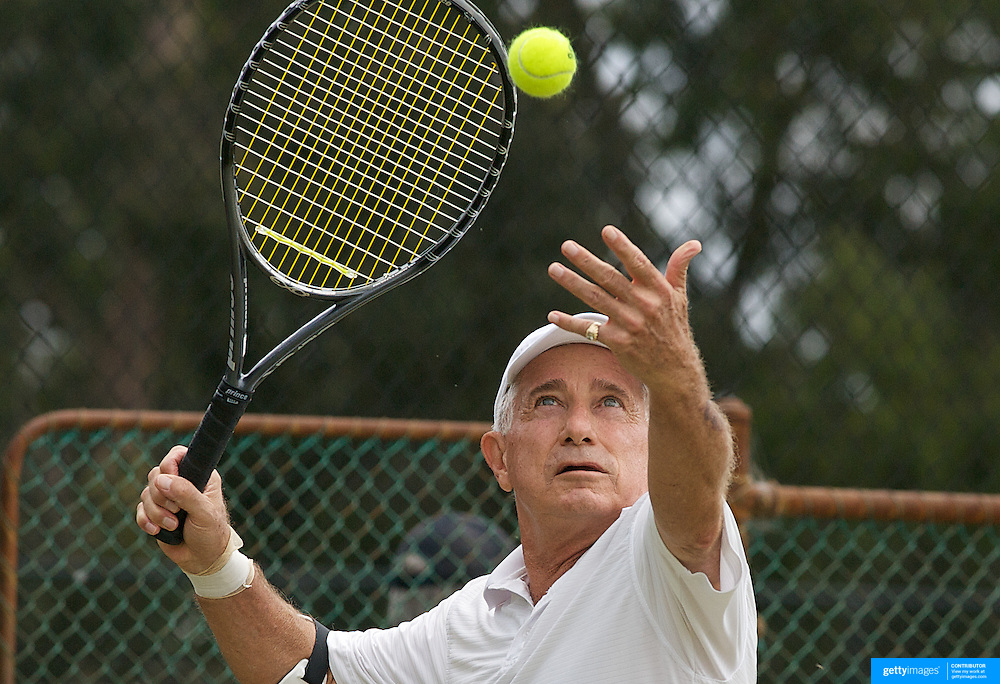 George Sarantos, USA, in action against Mose Harvey, New Zealand,  during the Jack Crawford Cup match during the 2009 ITF Super-Seniors World Team and Individual Championships at Perth, Western Australia, between 2-15th November, 2009.