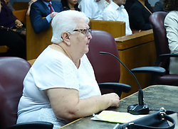 August 16, 2017 - Miami, FL, USA - Gladys Coego, convicted of voter raud, listens as relatives talk about her in Miami-Dade court on Wednesday, Aug. 16, 2017. She was sentenced to two years of house arrest. (Credit Image: © David Ovalle/TNS via ZUMA Wire)