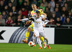 SWANSEA, WALES - Thursday, February 20, 2014: Swansea City's Pablo Hernandez in action against SSC Napoli's Gokhan Inler during the UEFA Europa League Round of 32 1st Leg match at the Liberty Stadium. (Pic by David Rawcliffe/Propaganda)