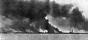 Dunkirk in flames from German bombardment as the British Expeditionary Force and French and Belgian troops were evacuated from the town and the beaches, 27 May to 3 June 1940.