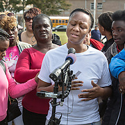 OXON HILL, MD-OCT20: Lakisha Jenkins, the mother of  Keyshaun Mason,14, who was stabbed to death by Jenkins' live-in boyfriend, cries at a press conference outside Potomac High School in Oxon Hill, MD, October 20, 2105. During a domestic dispute, Lakisha Jenkins, was barricaded in the master bedroom of her home by her live-in boyfriend, 48-year-old Sean Crawford. Crawford was armed with a kitchen knife. Keyshaun Mason, 14, and his 18-year-old brother attempted to enter the master bedroom to ask Crawford to leave their home. According to the documents, Crawford then stabbed Keyshaun in the chest. Both teens were taken to a local hospital where Keyshaun was pronounced dead. His brother was treated at the hospital and released. (Photo by Evelyn Hockstein/For The Washington Post)