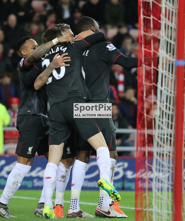 Christian Benteke celebrates with team-mater after  opening the scoring during the Sunderland FC v Liverpool FC English Premier League 30th March 2015...©Edward Linton | SportPix.org.uk