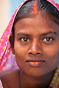 "Portrait of a young woman in the ""galis"" (alleyways) of the Old City of Varanasi India."