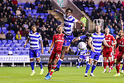 Reading midfielder Oviemuno Ejaria (14) heads clear during the EFL Sky Bet Championship match between Reading and Fulham at the Madejski Stadium, Reading, England on 1 October 2019.