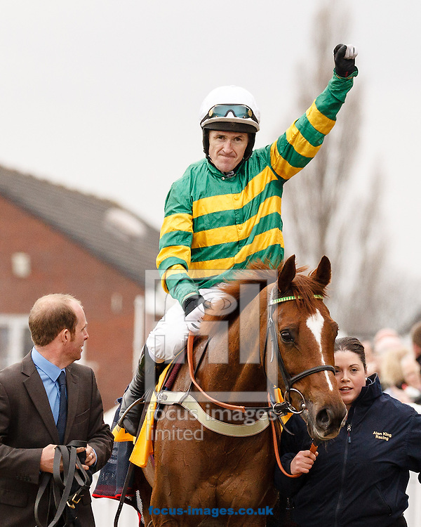 Uxizandre gives A P McCoy his first Festival win in the Ryanair Chase on St Patrick's Thursday of the 2015 Festival at Cheltenham Racecourse, Cheltenham<br /> Picture by Mark Chappell/Focus Images Ltd +44 77927 63340<br /> 12/03/2015