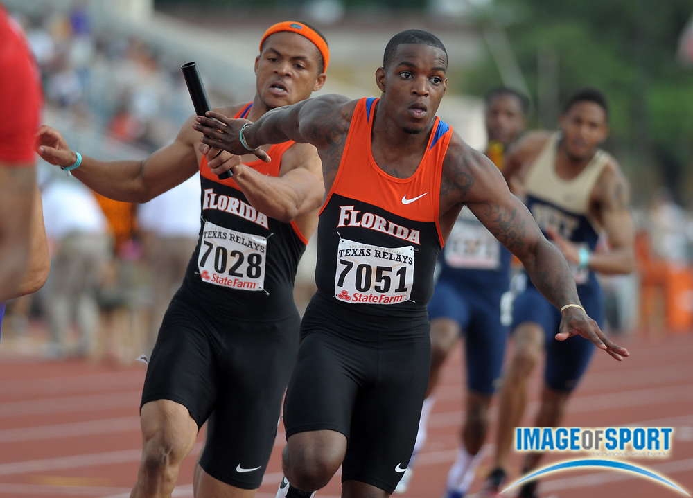Mar 30, 2012; Austin, TX, USA; Leonardo Seymore takes the handoff from Hugh Graham on the third leg of the Florida 4 x 100m relay heat that ran 39.73 in the 85th Clyde Littlefield Texas Relays at Mike A. Myers Stadium.