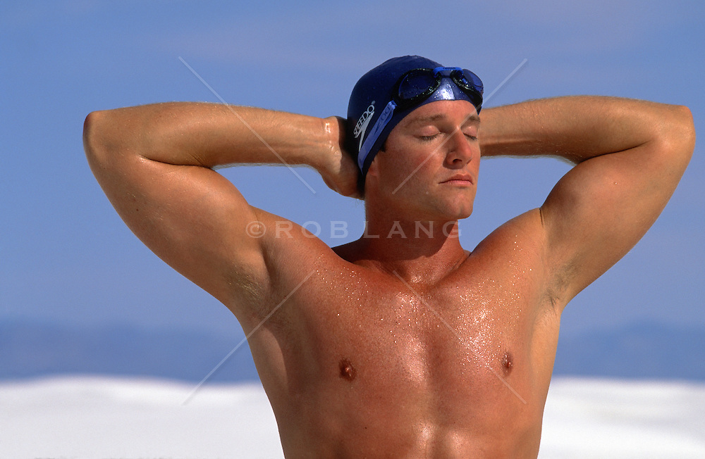 man wearing a swim cap outdoors in White Sands, NM