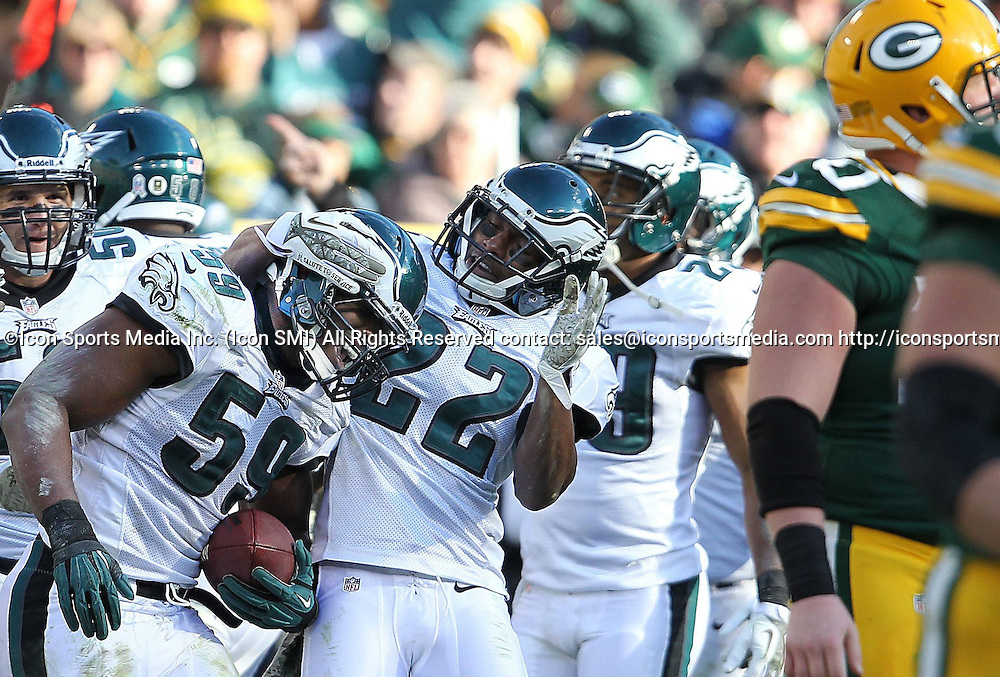 Nov. 10, 2013 - Green Bay, WI, USA - DeMeco Ryans, left, of the Philadelphia Eagles celebrates with teammate Brandon Boykin, center, after intercepting a pass against the Green Bay Packers during the 3rd quarter at Lambeau Field in Green Bay, Wis., on Sunday, Nov. 10, 2013. The Eagles beat the Packers, 27-13
