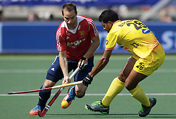 DEN HAAG - Rabobank Hockey World Cup<br /> 08 Korea - New Zealand<br /> Foto: Nick Catlin (red) and Birendra Lakra (yellow).<br /> COPYRIGHT FRANK UIJLENBROEK FFU PRESS AGENCY