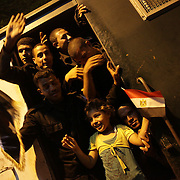Egyptians of all ages celebrate with the national security police  the departure of ex president Morsi in the early hours of the morning - Cairo 04/07/2013