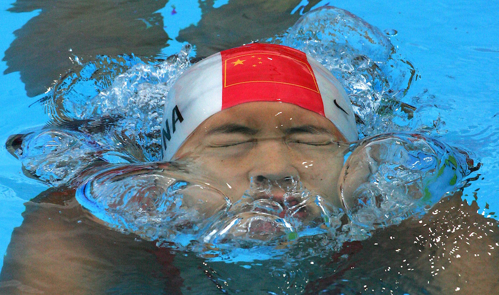 China's Gao Chang comes up from under a lane divider as she leaves the pool after finishing the semi-final of the women's 50m backstroke in Championship record time of 28.31 at the FINA World Championships in Montreal, Canada Wednesday 27 July, 2005.