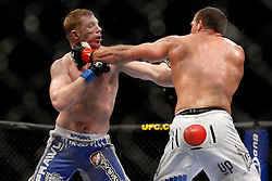 October 24, 2009; Los Angeles, CA; USA; Ryan Bader (white trunks) hits Eric Schafer (blue trunks) during their bout at UFC 104. Bader won via unanimous decision.  Mandatory Credit:  Ed Mulholland