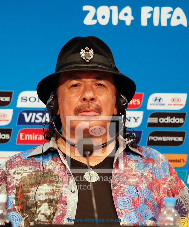 Musician Carlos Santana looks on during the FIFA Daily Press Conference at Maracana Stadium, Rio de Janeiro.<br /> Picture by Andrew Tobin/Focus Images Ltd +44 7710 761829<br /> 12/07/2014