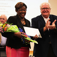 Belle-Shivers Middle School Principal Karen Howard, pictured with school board president Jim Edwards, smiles after being named district administrator of the year.