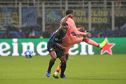 November 6, 2018 - Milan, Milan, Italy - Kwadwo Asamoah #18 of FC Internazionale Milano competes for the ball with Ousmane Dembélé #11 of FC Barcelona during  the UEFA Champions League group B match between FC Internazionale and FC Barcelona at Stadio Giuseppe Meazza on November 06, 2018 in Milan, Italy. (Credit Image: © Giuseppe Cottini/NurPhoto via ZUMA Press)