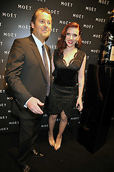 Scarlett Johansson and President of Moet and Chandon Frederic Cumenal at the Moet & Chandon Tribute to Cinema party held at the Big Sky Studios, Brewery Road, London N7 on 24th March 2009.
