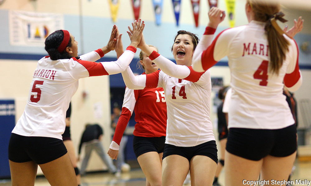 Marion junior Jessica Jakoubek (14) celebrates a point with senior Morgan Paige (5) during their match against Davenport West at the Westside Volleyball Invitational at Jefferson High School in Cedar Rapids on Saturday October 10, 2009. Marion won the match 21-13, 21-11.
