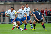 Anthony Perenise of Bath Rugby runs past Hamish Watson of Edinburgh Rugby during the Rugby Friendly match between Edinburgh Rugby and Bath Rugby at Meggetland Sports Complex, Edinburgh, Scotland on 17 August 2018.
