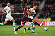 Callum Wilson (13) of AFC Bournemouth and Norwich City defender Christoph Zimmermann (6) during the EFL Cup 4th round match between Bournemouth and Norwich City at the Vitality Stadium, Bournemouth, England on 30 October 2018.